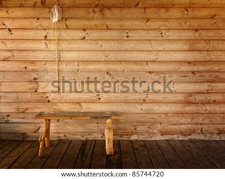 butterfly net and bench against wooden wall - stock photo