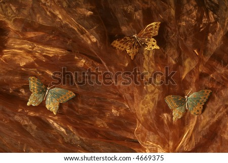Butterfly on copper color silk fabric