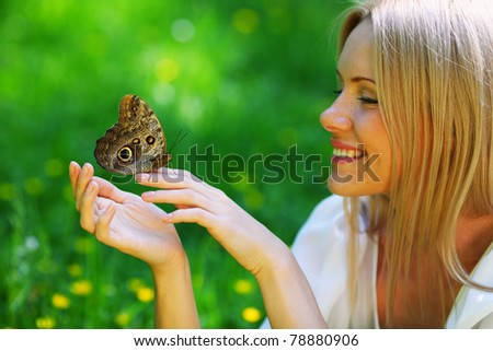 butterfly on woman hand - stock photo
