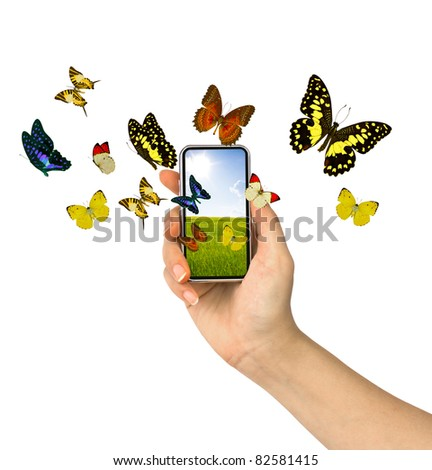 Butterfly reaches out of phone - stock photo