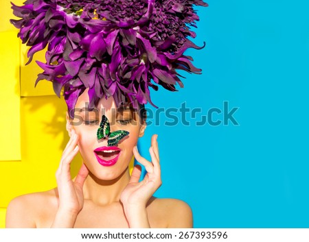 Butterfly sat on the girl's nose - stock photo