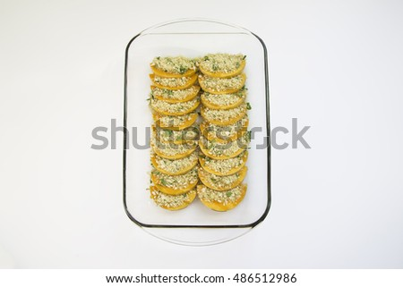Butternut squash bake with breadcrumbs and parsley on white background