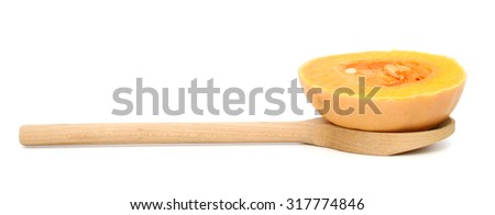 butternut squash slice on wooden spoon isolated on white