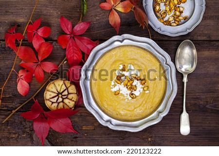 Butternut squash soup with feta crumbled on top - stock photo