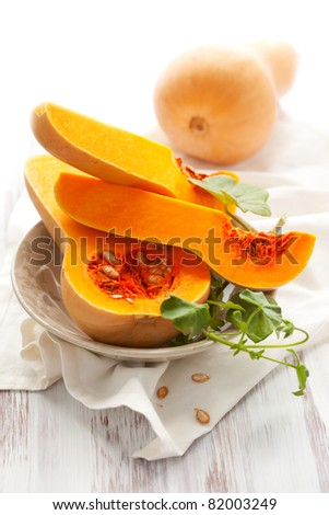 Butternut squash, whole and halved - stock photo