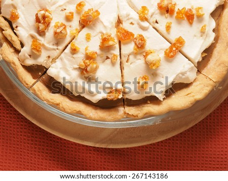 Butterscotch Cream Pie with caramel on topping - stock photo