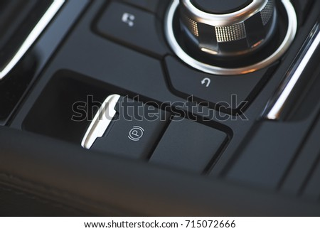 Button of the electric brake of a car. Car dashboard.