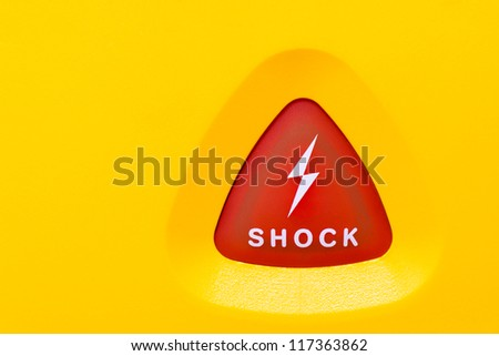 Button on an AED to apply an electro shock to a person with a heart failure - stock photo