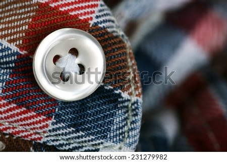 Button on clothes close up - stock photo