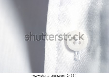 Button on linen shirt.