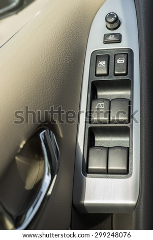 button on the door of the driver's seat - stock photo