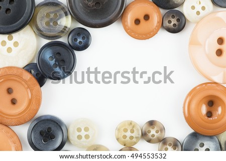 Button texture with orange and black tones and copy space.
