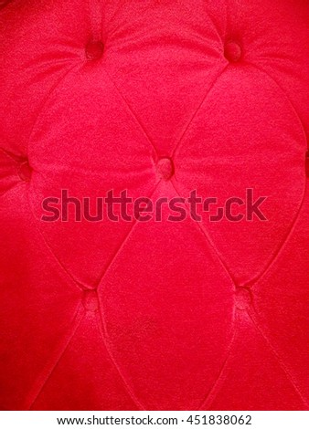Buttoned on the red Texture, vertical - stock photo
