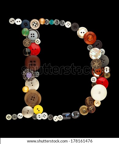 Buttons alphabet - letter D- isolated on black - stock photo
