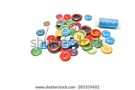 buttons and spool of thread on white - stock photo