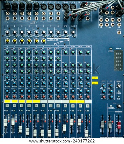 Buttons and tabs in various parts of the audio controller - stock photo
