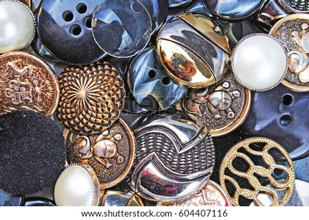 Buttons background. Colored shiny clothing button texture. Colored sewing buttons pattern concept wallpaper. Mixed colors. Studio photo texture photography.