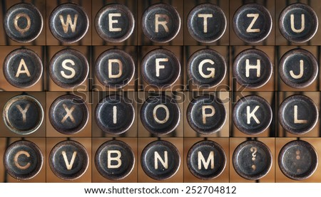 Buttons from an old dusty typewriter, as font.  - stock photo