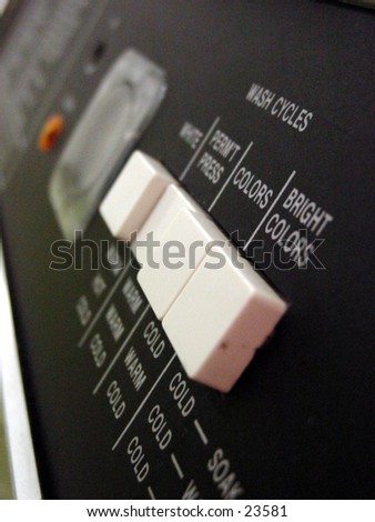 Buttons on a washing machine in a laurdromat - stock photo