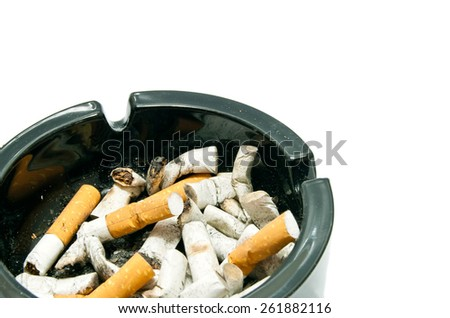 butts in black ashtray on white background - stock photo