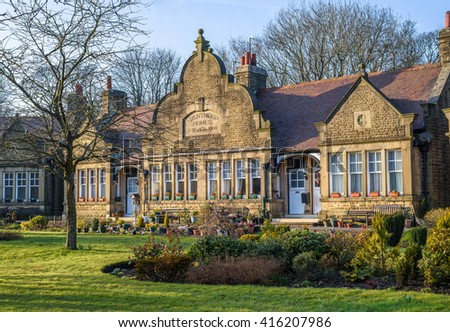 BUXTON, UK - MARCH 17, 2016: BUXTON, UK - MARCH 17, 2016: Milnthorpe Homes, charitable almshouses built 1904 and designed by W R Bryden.
