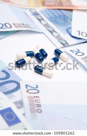 Buy health concept - drugs and money. Medicine and healthcare is a business. Financing medicine.