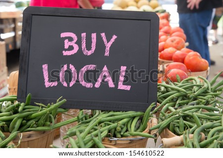Buy Local Chalkboard Sign With Baskets of Green Beans and Tomatoes For Sale at the Farmers Market - stock photo