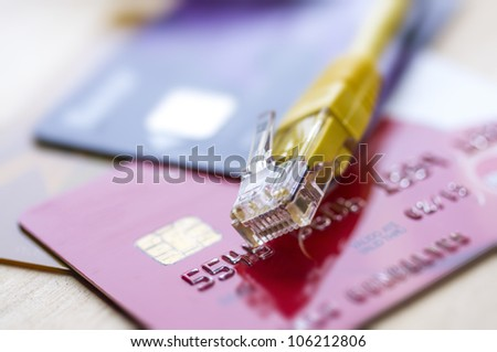 Buy online concept with credit cards and internet connection - stock photo