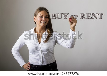 BUY or RENT - Beautiful girl writing on transparent surface - horizontal image