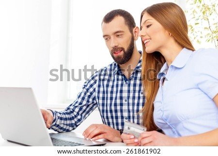 Buy. Portrait Of Happy Couple Shopping Online Using Laptop And Credit Card - stock photo