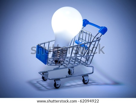 Buy the Light. Shopping cart with light bulb. - stock photo