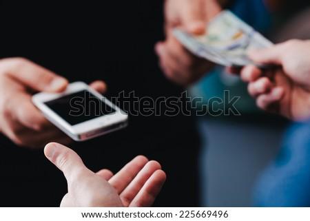 buy used smartphone - stock photo