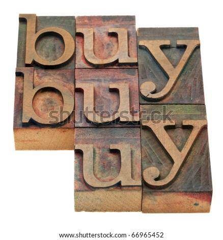 buy word abstract in vintage wooden letterpress printing blocks, stained by color inks, isolated on white