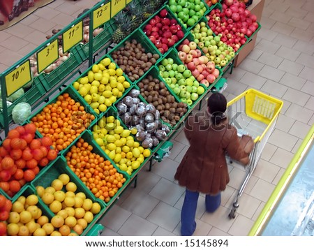 buyer chooses fruits in the supermarket - stock photo