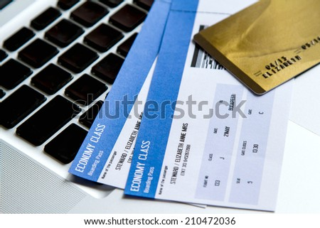 Buying airline tickets on line with a credit card  - stock photo