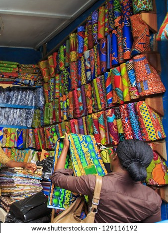 Buying fabric at the market - stock photo