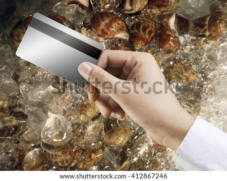 Buying shellfish on the market pay by credit card in market