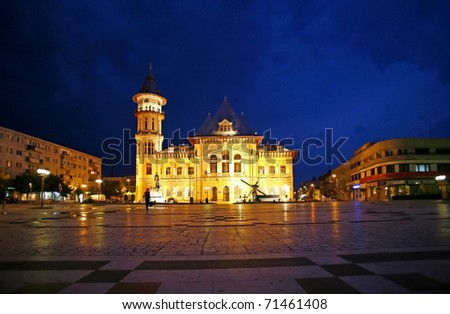 Buzau city hall at night, Romania.The Communal Palace in Dacia Square, BuzÃ?Â?u