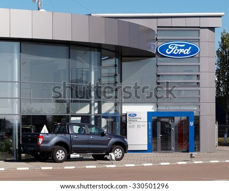 BUZAU, ROMANIA - OCTOBER 21, 2015. Ford dealership building. The Ford Motor Company is an American multinational automaker. It was founded by Henry Ford. - stock photo