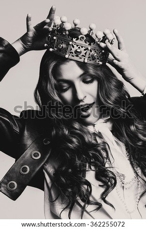 bw dynamic woman in leather jacket with crown in studio