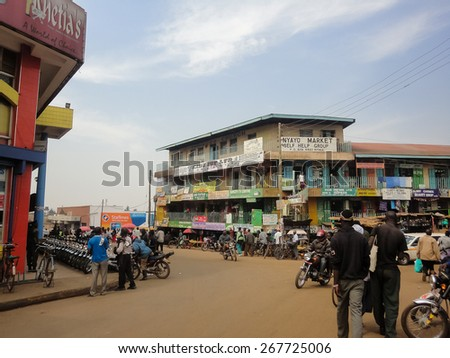 BWAYI, KENYA - FEBRUARY 13, 2014: Unidentified people on the street of Kitale, Kenya. Kitale is an agricultural town in western Kenya at an elevation of around 1,900 metres. - stock photo