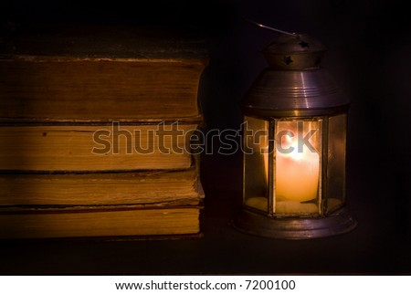 By the light of a candle old books