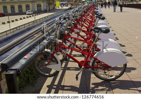 Bycicles rental service in Barcelona (Spain), on the street - stock photo
