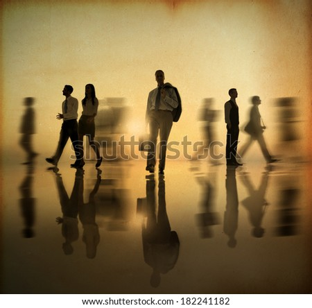 Bysy Business People Walking at Sunset - stock photo