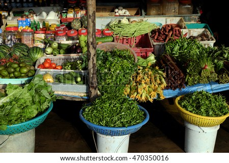 CA MAU, VIET NAM- JULY 15, 2016: Roadside food stalls at Mekong Delta countryside, farmer market sell green vegetable from agriculture product, Camau, Vietnam