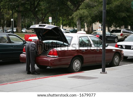 Cab driver loading the trunk
