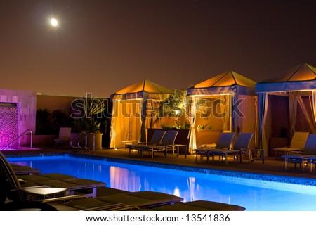 Cabana and Swimming Pool at night - stock photo