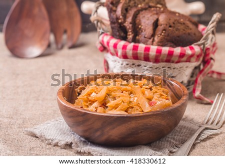 Cabbage stewed  in portions wooden plate - stock photo