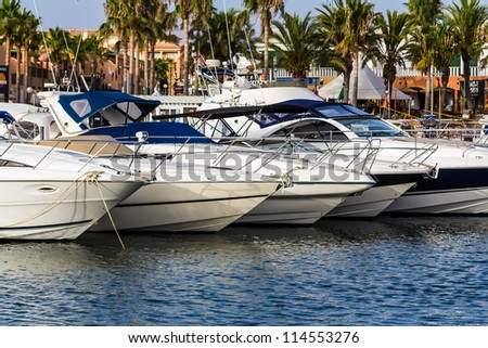 Cabin cruisers in harbour Menorca mediterranean - stock photo