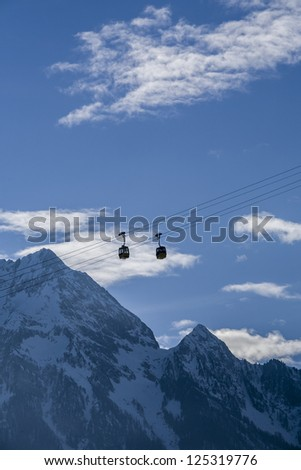 Cabin lift hanging in the air in a ski area - stock photo